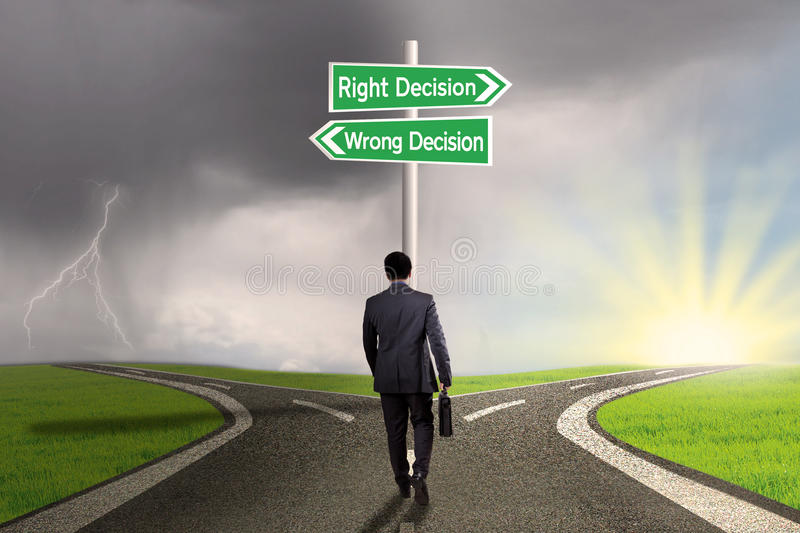 Worker facing two choices on the road stock image