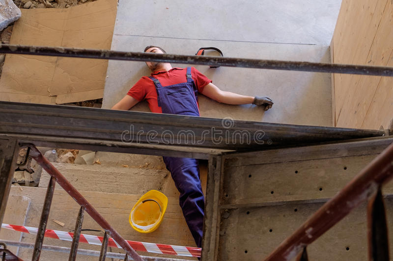 Worker in a faint after on-the-job injury. Worker in a faint after an on-the-job injury royalty free stock photos