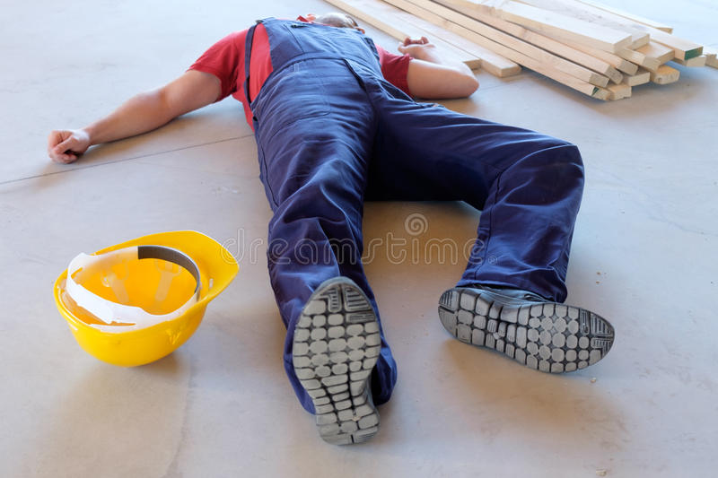 Worker in a faint after on-the-job injury. Falled royalty free stock images