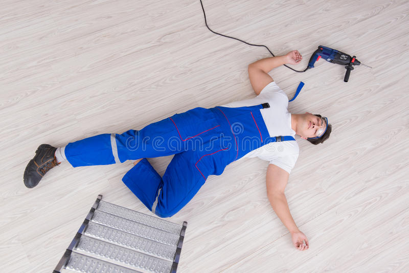 The worker after falling from height - unsafe behavior. Worker after falling from height - unsafe behavior royalty free stock image