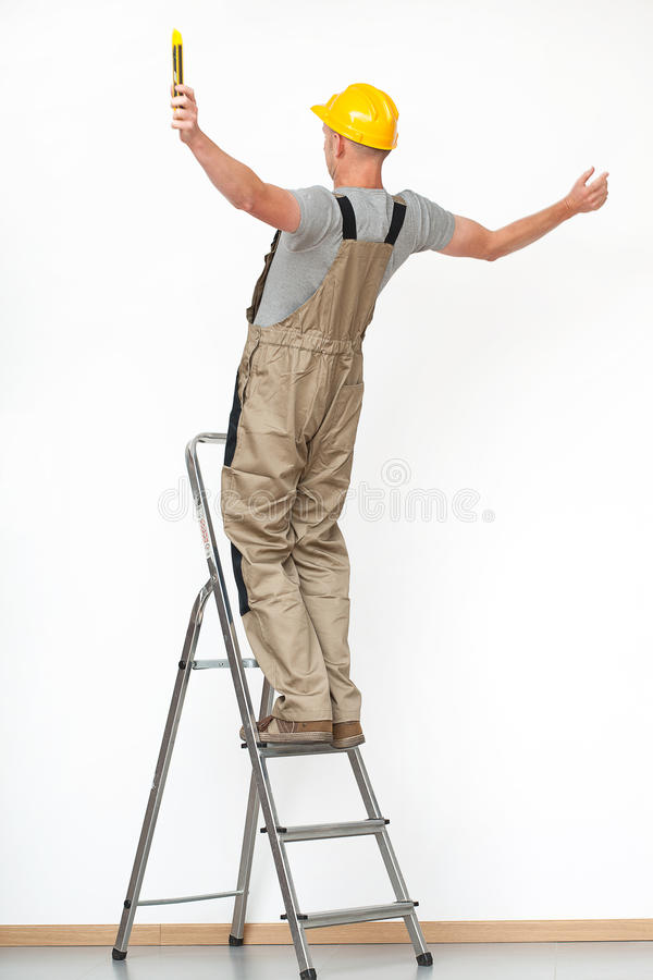 Worker falling from ladder royalty free stock image
