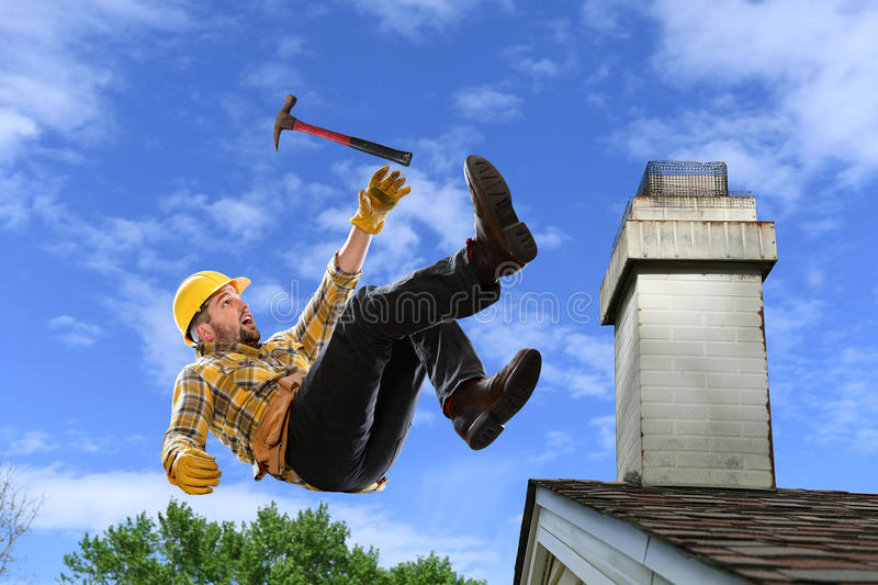 Worker Falling from Roof. Worker using hammer falling from edge of roof royalty free stock photo