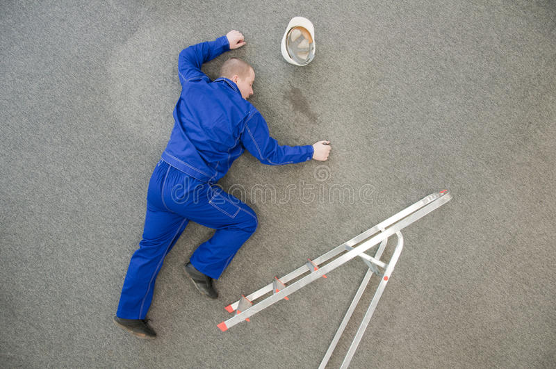Worker fell from a ladder stock photography