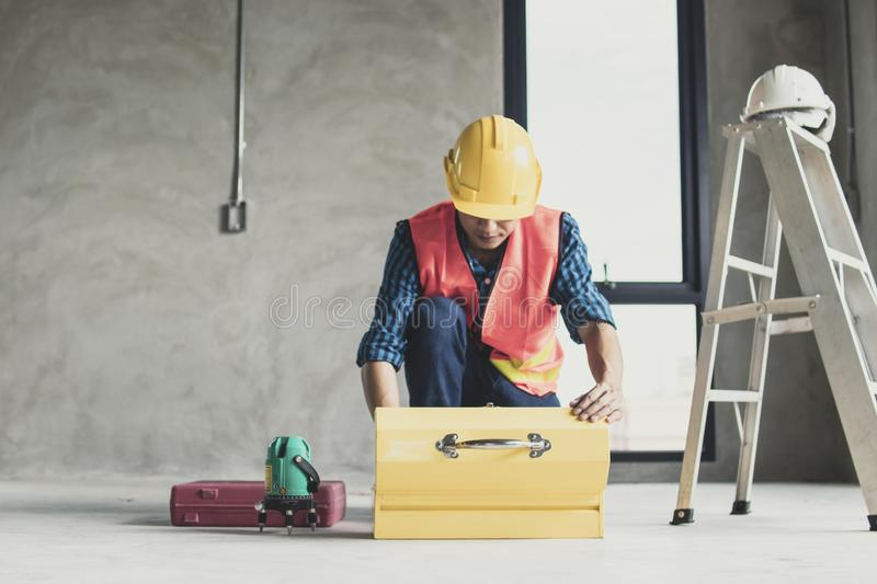 Worker finding tools in construction box in working site royalty free stock image