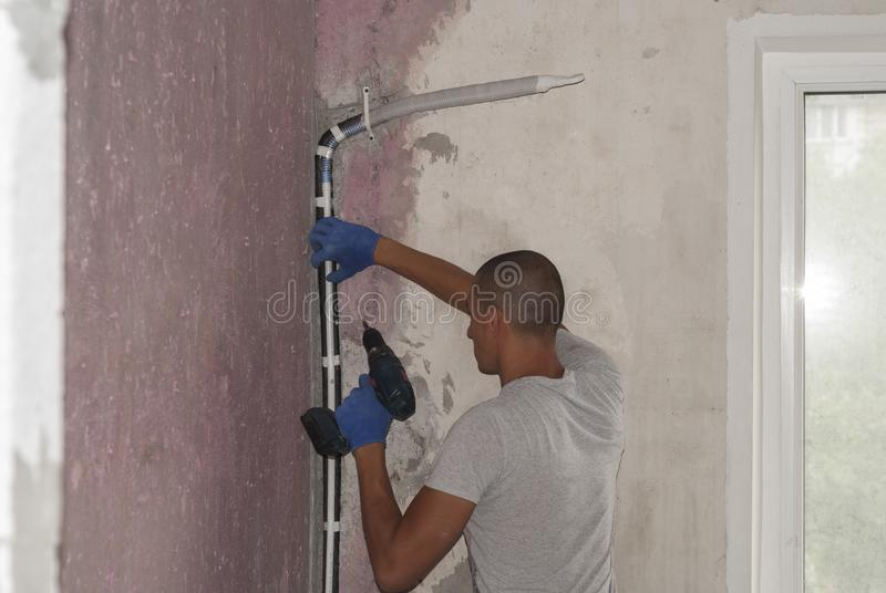 Installation of air conditioning pipes stock photos