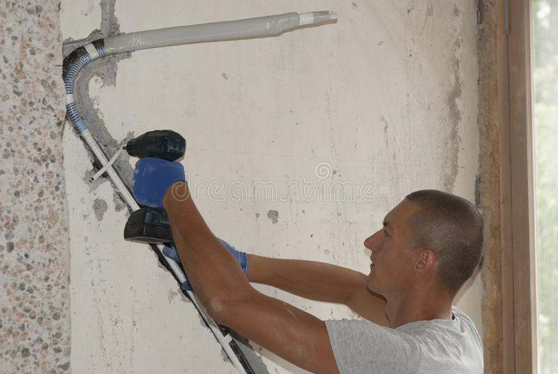 Installation of air conditioning pipes stock images