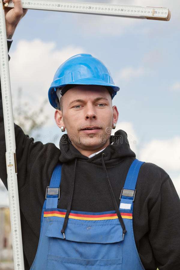 Worker with foldable ruler royalty free stock images