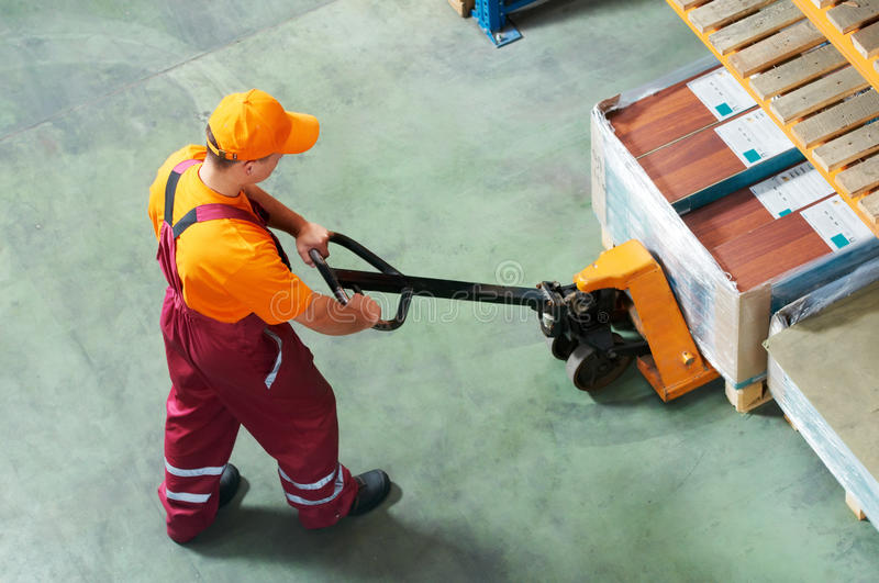 Worker with fork pallet truck stock photos