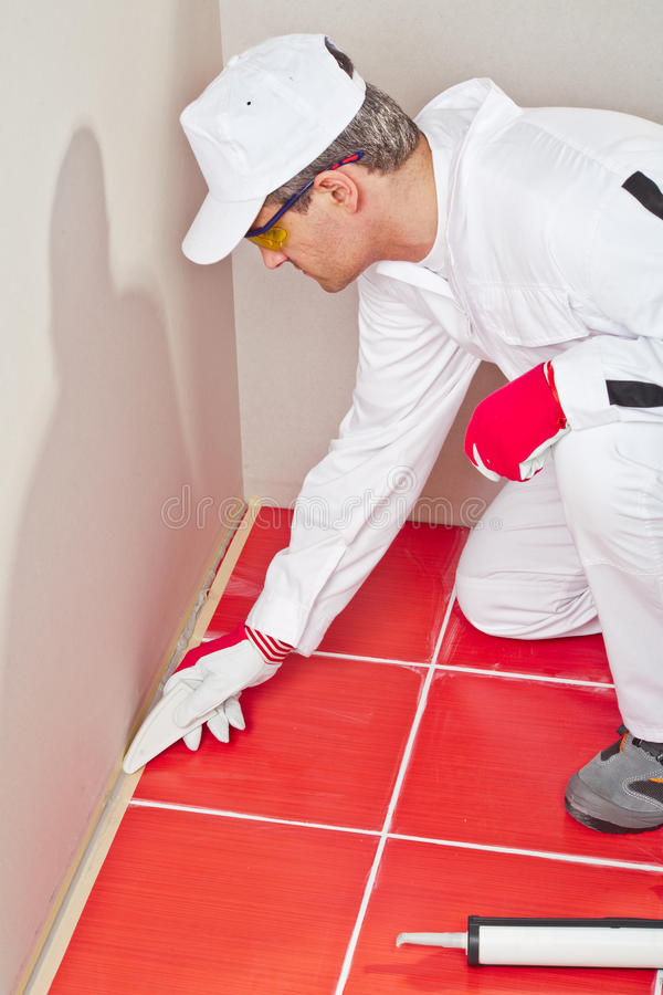 Download Worker Formed Silicone Sealant Stock Image - Image: 25671523