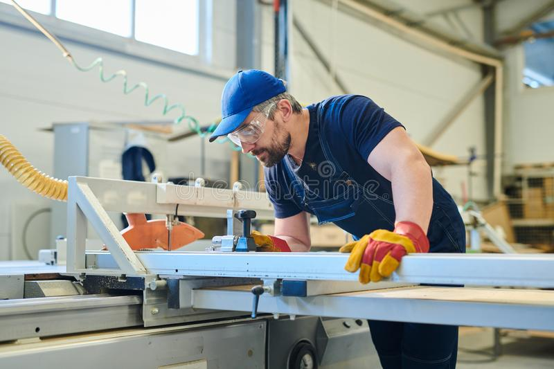 Worker of furniture factory royalty free stock image