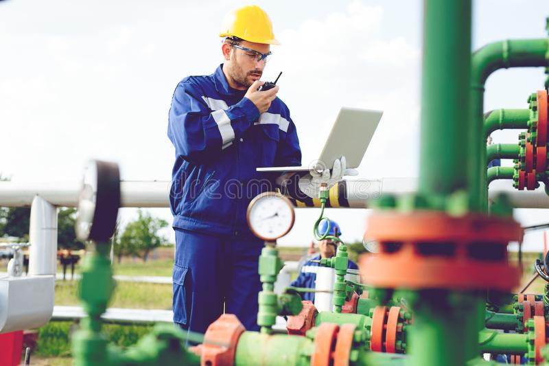 The worker of the gas refinery. Young worker of the gas refinery royalty free stock photography