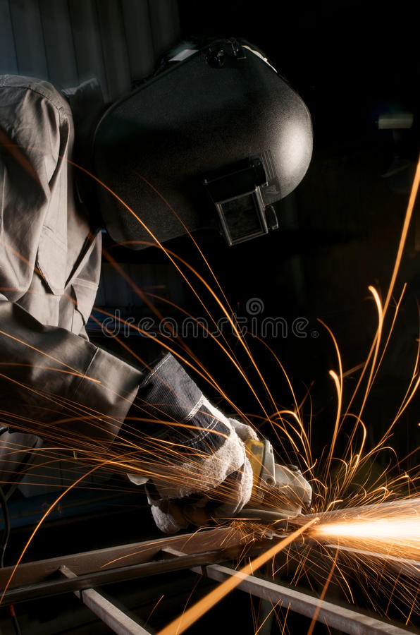 Worker grinding stock image