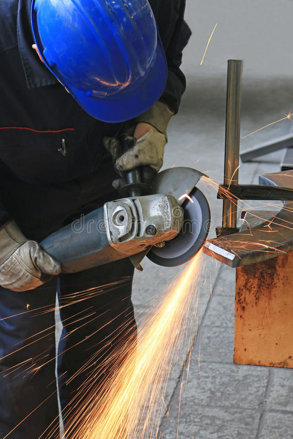 Free Worker Grinding A Metal Part Royalty Free Stock Photography - 86587957