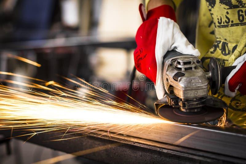 Worker grinding steel stock image