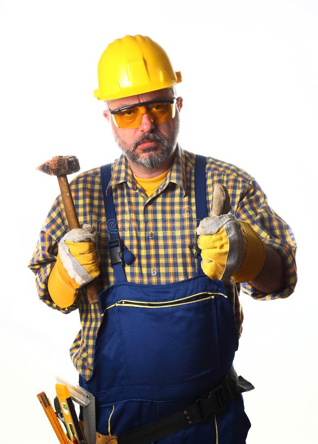 Worker with hammer. Thumb up royalty free stock photography