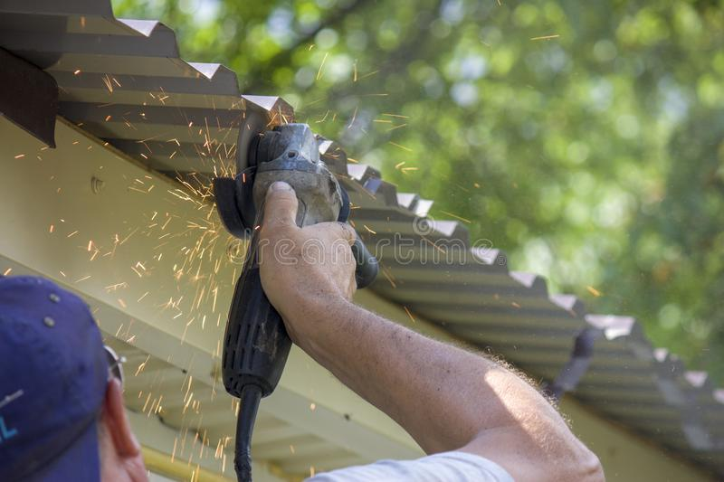 worker hand man holding broken grinder blade. Danger of using power tools. Close-up stock image