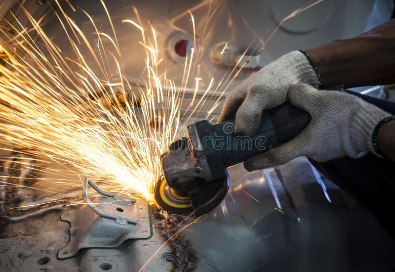worker hand working by industry tool cutting steel with split fire use for industrial manufacturing theme stock images