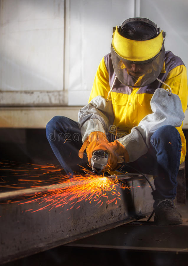 Worker hard work Electric wheel grinding stock images