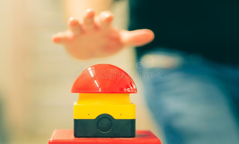 Worker has to press the emergency button fast.  stock image