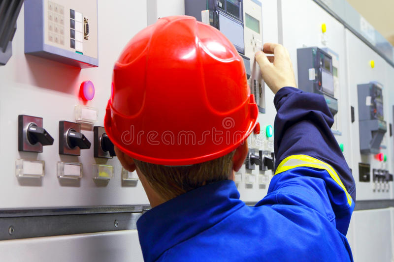 Worker in a helmet, the electrician royalty free stock image