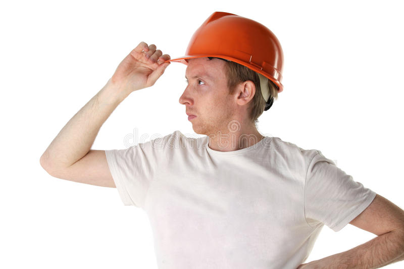 Download Worker In Helmet Looks Into The Distance Stock Image - Image: 15189231