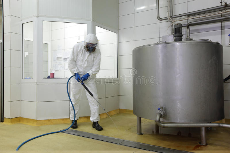 Worker With High Pressure Washer Cleaning Floor Stock