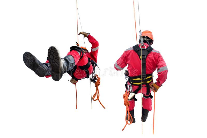Worker on high wear safety harness, demonstration of rappelling safety concept. royalty free stock photos