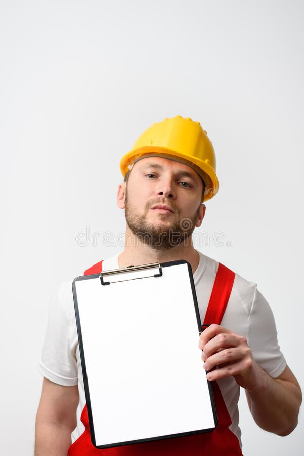 Worker holding blank clipboard on white background royalty free stock image