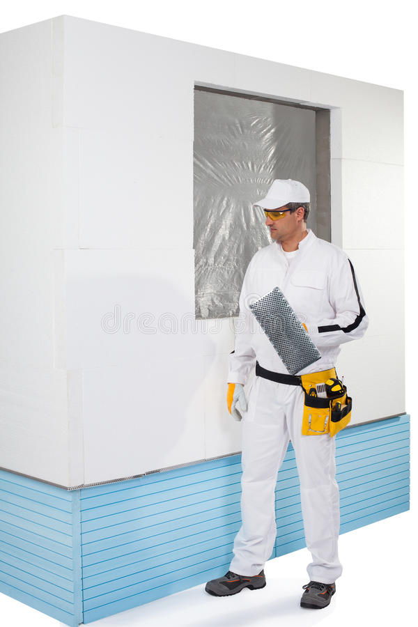 Download Worker Holding A Finishing Insulation Rasp Stock Photo - Image: 33943048