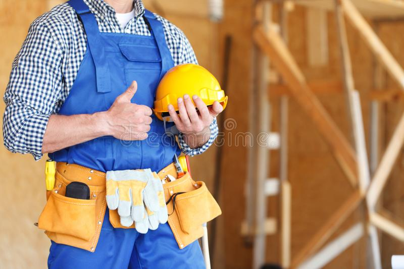 Worker gesturing thumbs up royalty free stock photos