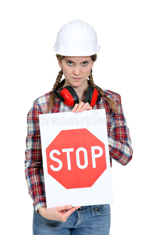Worker holding a stop sign royalty free stock images