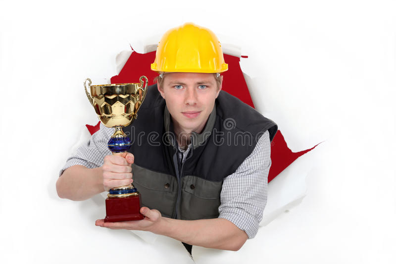 Download Worker Holding A Trophy Cup. Royalty Free Stock Image - Image: 28008506