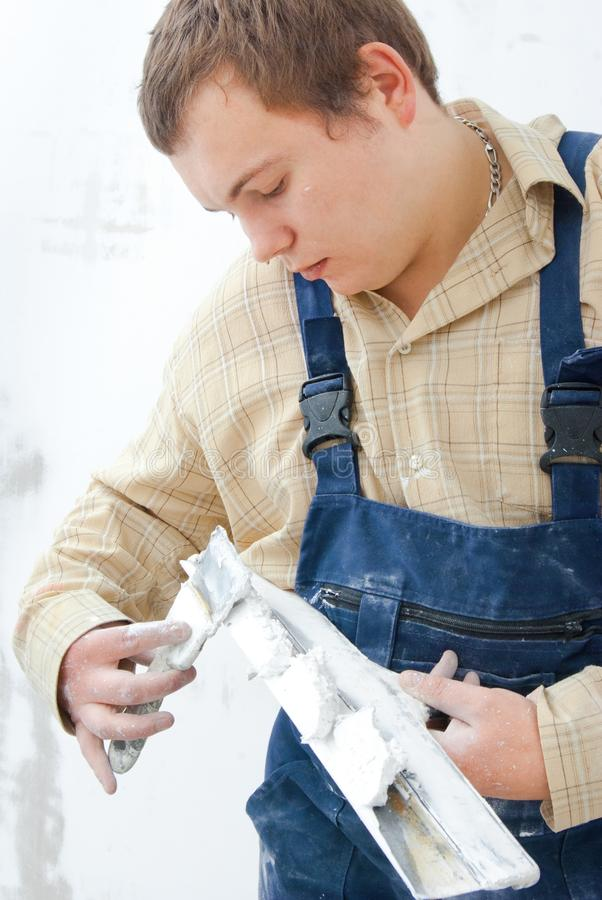 Worker holding trowel stock images