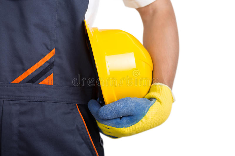 Worker holding yellow helmet stock photos