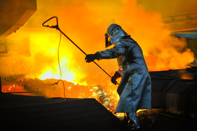 Worker with hot steel. And appropriate equipment stock photos
