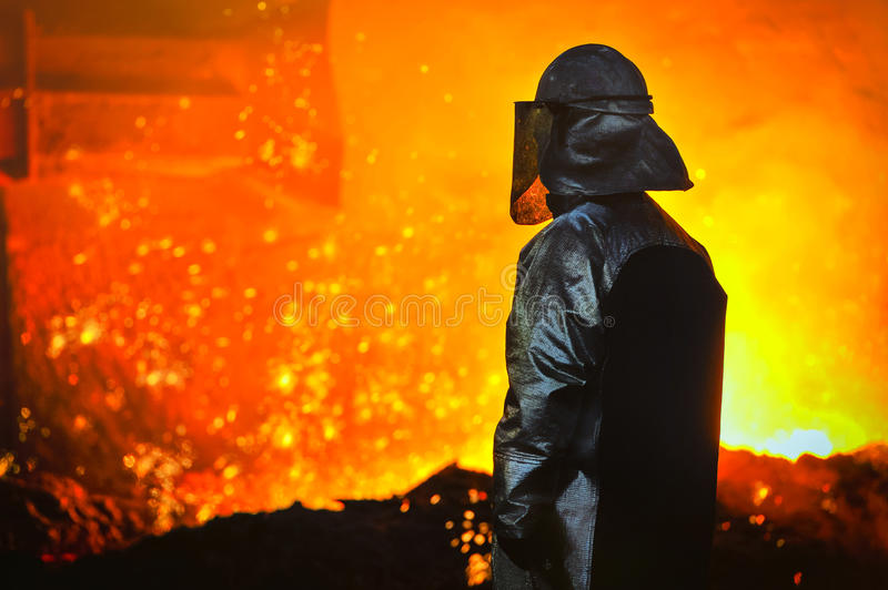 Worker with hot steel. In plant royalty free stock photography