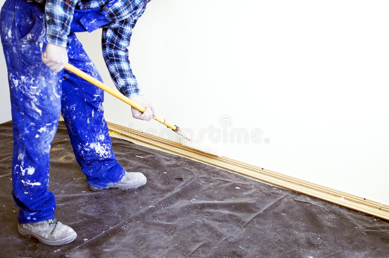 Worker house painter paints a wall royalty free stock photos