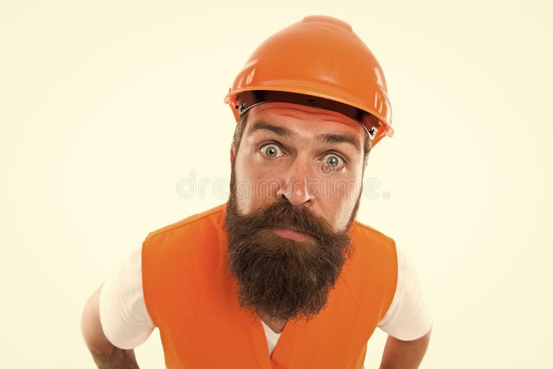 Worker in industry. Worker with confident look isolated on white. Hard worker wear safety hat and work vest royalty free stock photos
