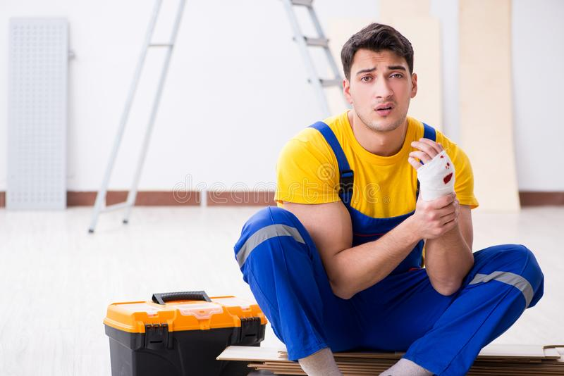The worker with injured hand at construction site royalty free stock photography