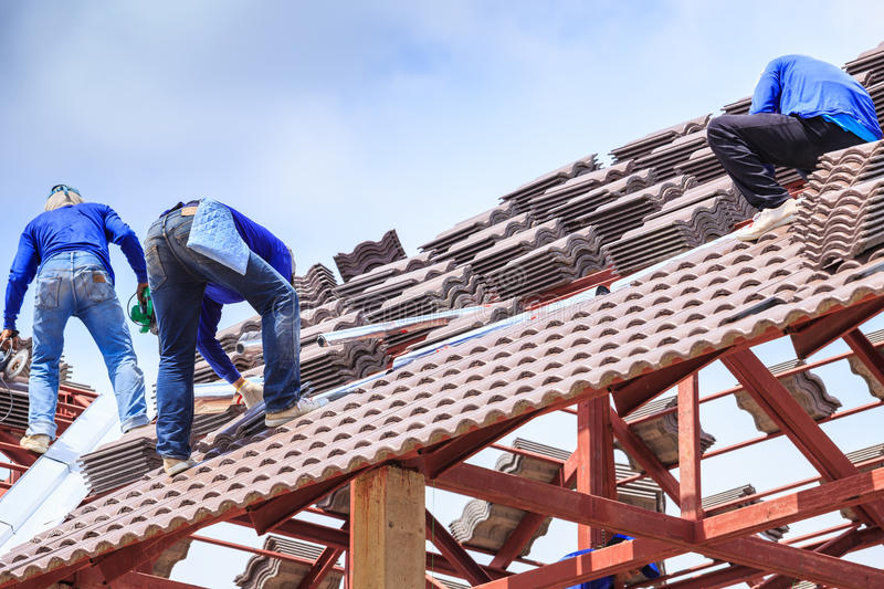 Worker install roof tile for new house royalty free stock images