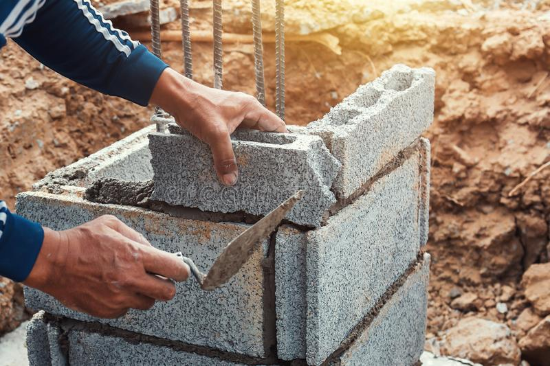 worker installing bricks in construction royalty free stock image