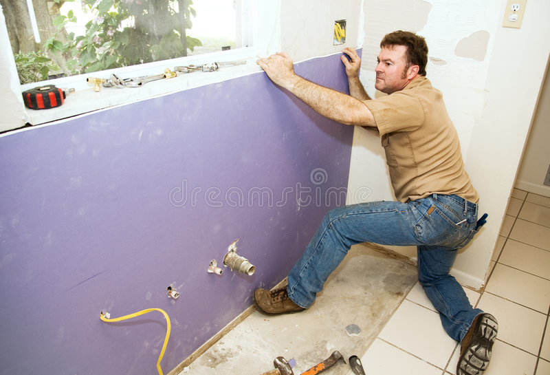 Worker Installing Drywall Stock Image