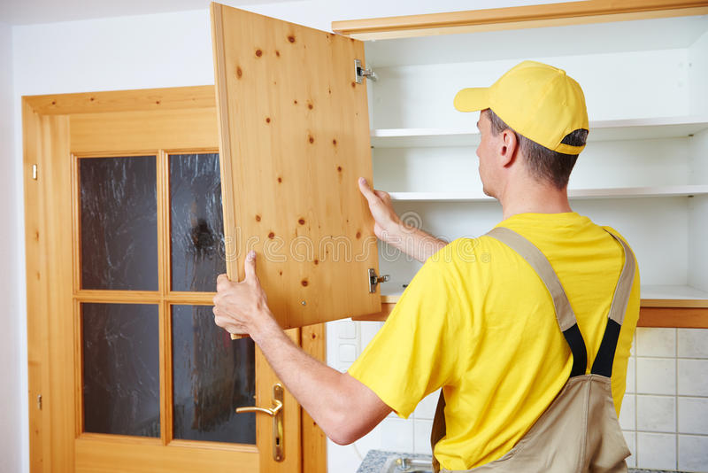 Worker Installing Kitchen Cupboard Stock Image - Image of male ...