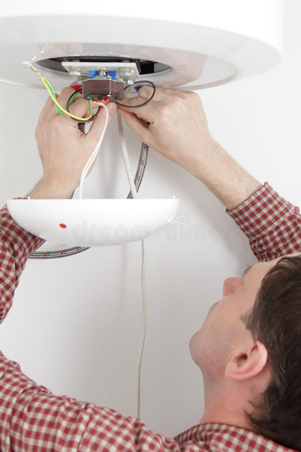 Download Worker Installing A Water Heater Stock Image - Image: 19392371