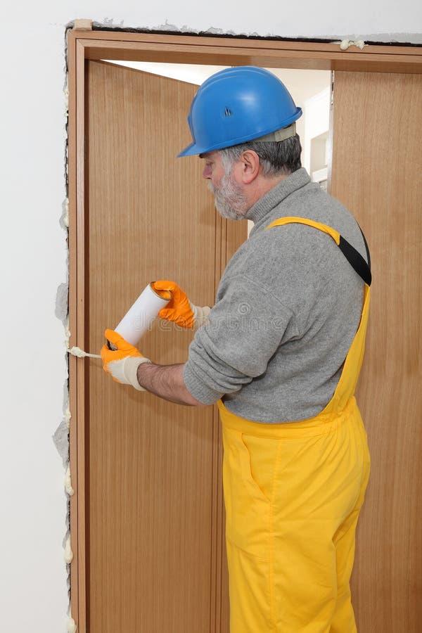 Download Worker Installing Wooden Door Using Polyurethane Foam Stock Image - Image 49829289 & Worker Installing Wooden Door Using Polyurethane Foam Stock Image ... pezcame.com