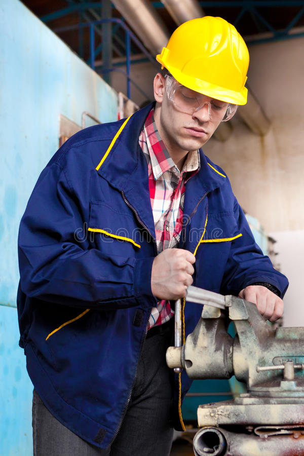 Download Worker on the job stock image. Image of yellow, metal - 23803817