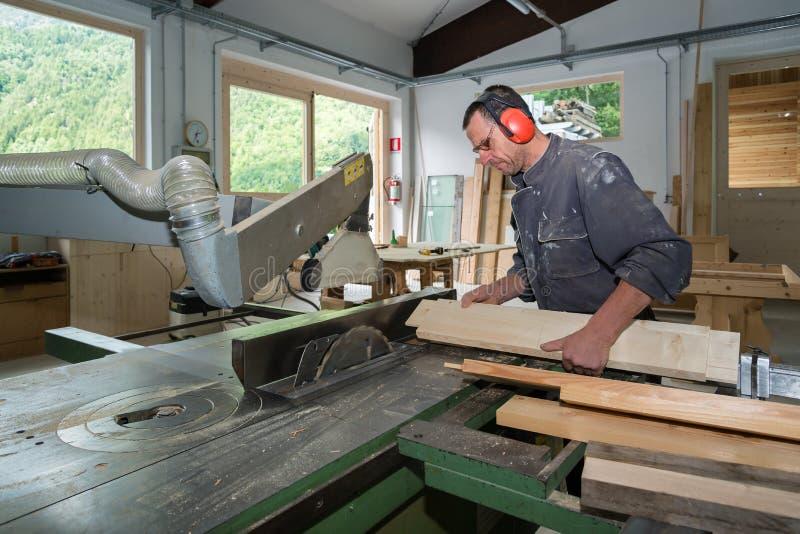Worker in joinery. Wood worker in joinery workshop stock photo