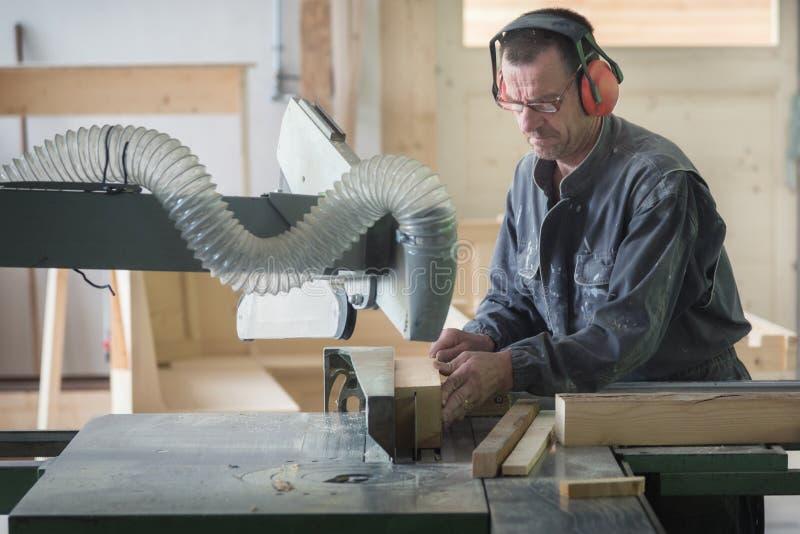 Worker in joinery. Wood worker in joinery workshop royalty free stock photos