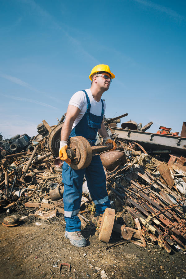 Worker in a junkyard. With yellow helmet royalty free stock photo