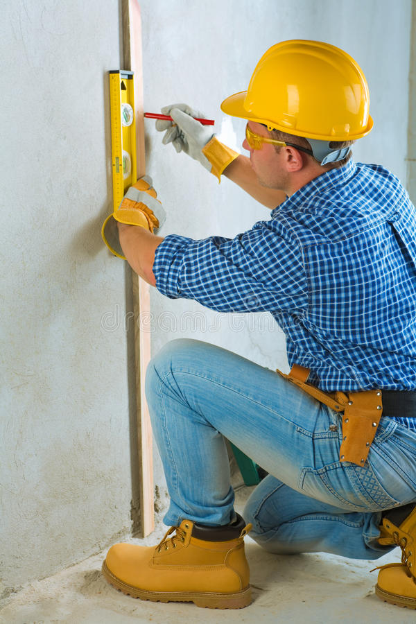 A worker layering on concrete wall stock image